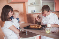 Happy family at kitchen Stock Image