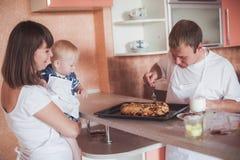 Happy family at kitchen Stock Image
