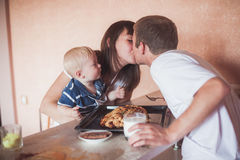 Happy family at kitchen Royalty Free Stock Photos