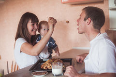 Happy family at kitchen Royalty Free Stock Image