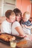Happy family at kitchen Royalty Free Stock Photo