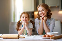 Happy family in kitchen. mother and child baking cookies stock photography
