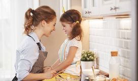 Happy family in kitchen. mother and child baking cookies Stock Photo