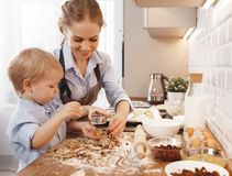 Happy family in kitchen. mother and child baking cookies. Happy family in kitchen. mother and child son baking cookies together Stock Photography