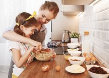 Happy family in kitchen. mother and child baking cookies Stock Photos