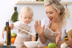 Happy family in the kitchen. Mother and child daughter cooking tasty breakfest Royalty Free Stock Photos