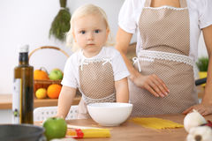 Happy family in the kitchen. Mother and child daughter cooking tasty breakfest. Happy family in the kitchen. Mother and child daughter  cooking tasty breakfest Stock Photos