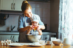 Happy family in kitchen. mother and child preparing dough, bake. Happy family in the kitchen. mother and child daughter preparing the dough, bake cookies royalty free stock photos