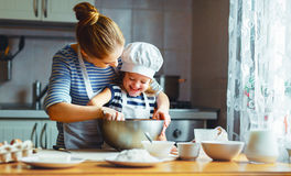 Happy family in kitchen. mother and child preparing dough, bake. Happy family in the kitchen. mother and child daughter preparing the dough, bake cookies stock photography