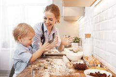 Happy family in kitchen. mother and child baking cookies Royalty Free Stock Images