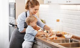 Happy family in kitchen. mother and child baking cookies. Happy family in kitchen. mother and child son baking cookies together Stock Image