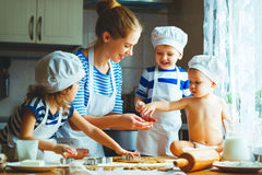 Happy family in kitchen. mother and children preparing dough, ba. Happy family in the kitchen. mother and children preparing the dough, bake cookies royalty free stock photo