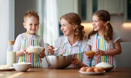 Happy family in kitchen. mother and children preparing dough, bake cookies. Happy family in the kitchen. mother and  children preparing the dough, bake cookies stock photography