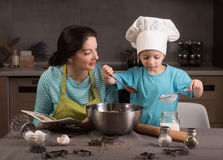 Happy family in the kitchen. Stock Photos