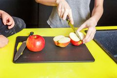 Mother and children cooking in kitchen and having fun stock photography