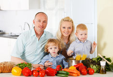 Happy family at kitchen. Royalty Free Stock Image