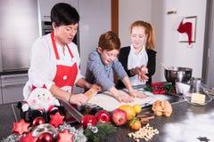 Happy family in the kitchen preparing christmas bakery Stock Photo