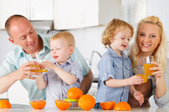 Happy family at kitchen. Stock Images