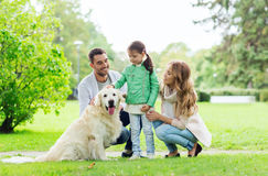 Happy family with labrador retriever dog in park Royalty Free Stock Images