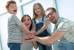 Happy family laid down their tower from their hands. Family team concept stock image