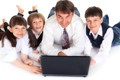 Happy family with laptop Stock Photos