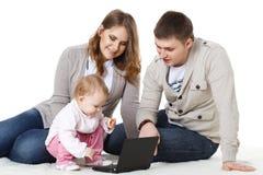 Happy family with laptop. Stock Photo
