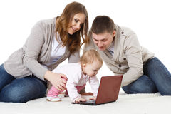 Happy family with laptop. Royalty Free Stock Photo