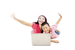 Happy family with laptop computer Royalty Free Stock Images