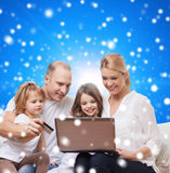 Happy family with laptop computer and credit card. Family, christmas holidays, shopping, technology and people - happy family with laptop computer and credit Stock Images