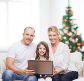 Happy family with laptop computer Stock Photo