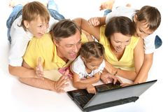 Happy family with laptop Stock Photo