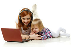 Happy family with laptop. Stock Images