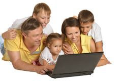 Happy family with laptop Stock Images