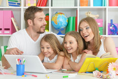 Happy family with laptop Stock Photography