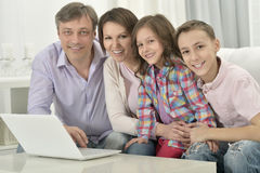 Happy family with laptop Royalty Free Stock Image