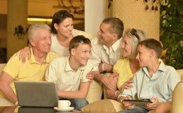Happy family with laptop Stock Photo