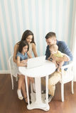 Happy family. Family with the laptop at the table royalty free stock photos