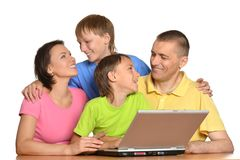 Happy family with laptop Royalty Free Stock Photography