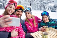 Family laughing and enjoying in winter vacation together on snow. Happy family laughing and enjoying in winter vacation together on snow and making selfie Royalty Free Stock Photos