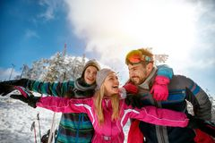 Family laughing and enjoying in winter vacations together on the Royalty Free Stock Photo