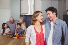 Happy family laughing in kitchen Stock Image