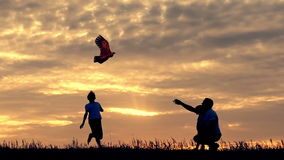 Happy family launches into the sky a kite flying stock video