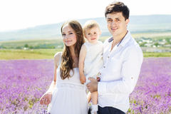 Happy family in lavender field Royalty Free Stock Photos