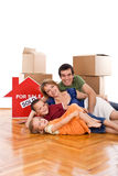 Happy family laying on the floor of their new home Royalty Free Stock Image