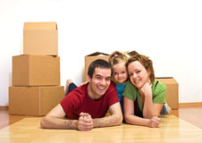 Happy family laying on the floor in their new home Royalty Free Stock Photo