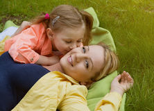 Happy family laying at grass Royalty Free Stock Image