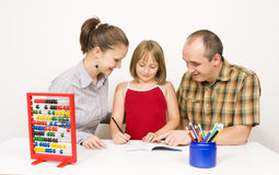 Happy family learning Royalty Free Stock Image