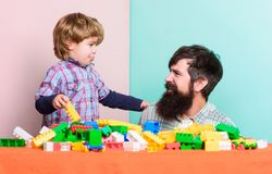 Happy family. leisure time. little boy with bearded man dad playing together. child development. building home with. Happy family. leisure time. little boy with royalty free stock images