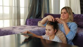 Family leisure weekend holiday pastime watching tv. Happy family leisure. weekend holiday pastime. mom and daughter watching tv at home stock footage