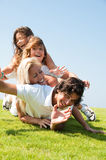 Happy family lie. Family having fun on meadow Royalty Free Stock Image